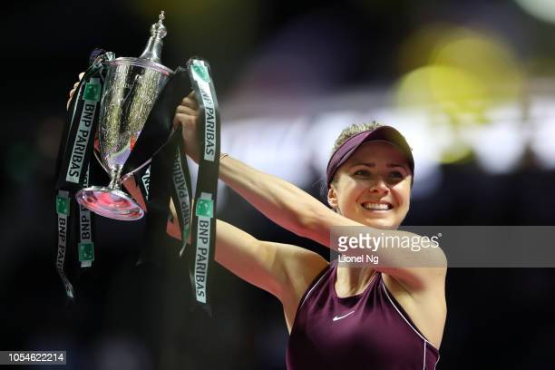 Elina Svitolina of Ukraine holds up the Billie Jean King trophy after winning the Women's Singles final on day 8 of the 2018 BNP Paribas WTA Finals...