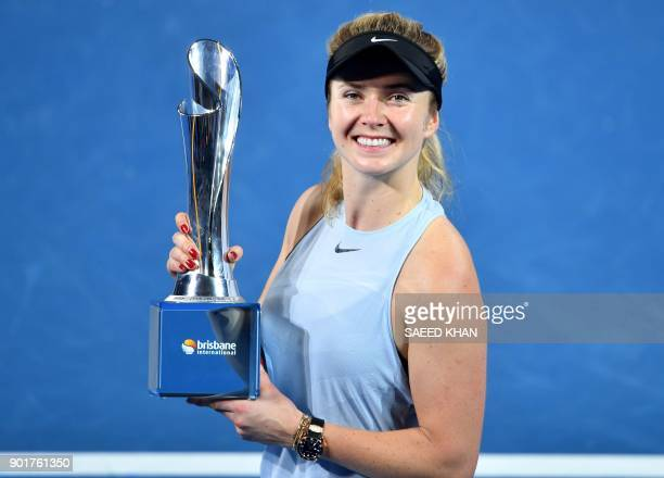 Elina Svitolina of Ukraine holds up the winner's trophy after beating Aliaksandra Sasnovich of Belarus in the women's singles final match of the...