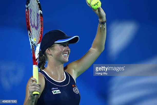 Elina Svitolina of Ukraine in celebrates after won her match against Angelique Kerber of Germany on day five of 2014 Dongfeng Motor Wuhan Open at...