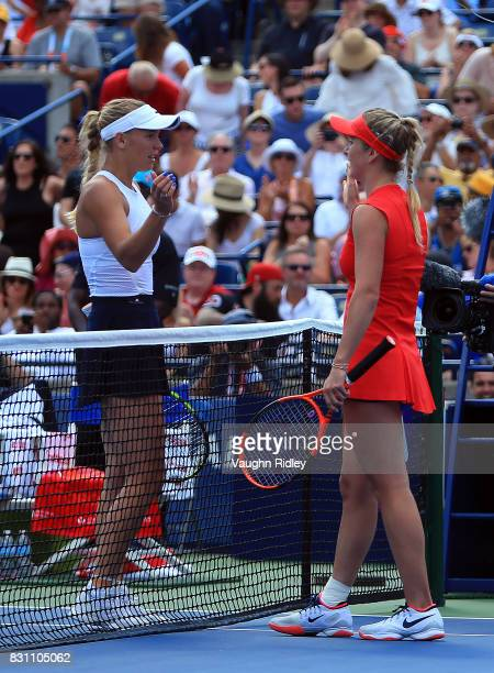 Elina Svitolina of Ukraine is congratulated by Caroline Wozniacki of Denmark following the final match on Day 9 of the Rogers Cup at Aviva Centre on...