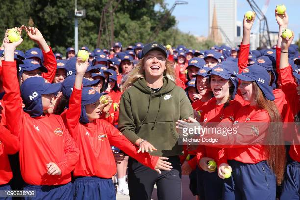 Elina Svitolina of Ukraine is greeted by over 300 ball kids ahead of the 2019 Australian Open at Melbourne Park on January 07 2019 in Melbourne...