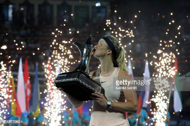 Elina Svitolina of Ukraine kisses the champion's trophy after winning the WTA Dubai Duty Free Tennis Championship on February 24 2018 / AFP PHOTO /...