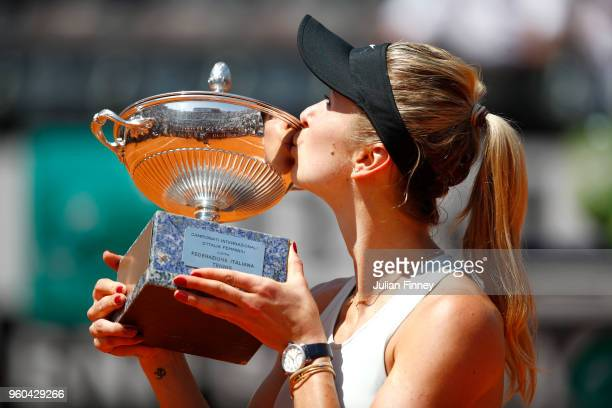 Elina Svitolina of Ukraine kisses the trophy in celebration after the Women's Singles final match between Simona Halep and Elina Svitolina on Day...