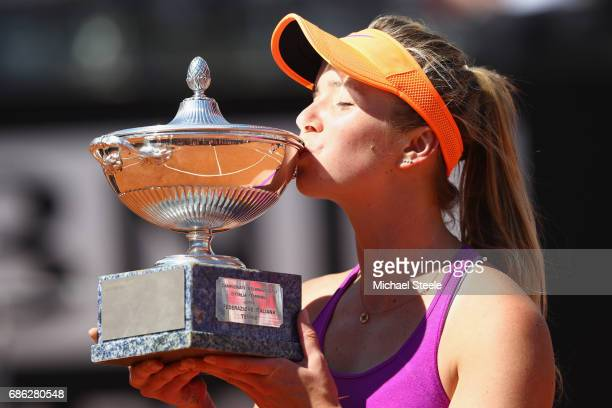 Elina Svitolina of Ukraine kisses the winners trophy after her victory in the women's final against Simona Halep of Romania on Day Eight of the...