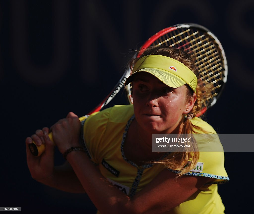 Elina Svitolina of Ukraine plays a backhand during her match against Mona Barthel of Germany during Day 6 of the Nuernberger Versicherungscup on May 22, 2014 in Nuremberg, Germany.