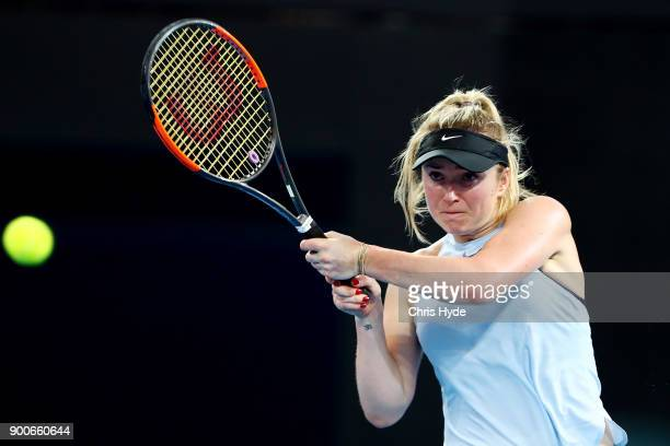 Elina Svitolina of Ukraine plays a backhand in her match against Ana Konjuh of Croatia during day four of the 2018 Brisbane International at Pat...