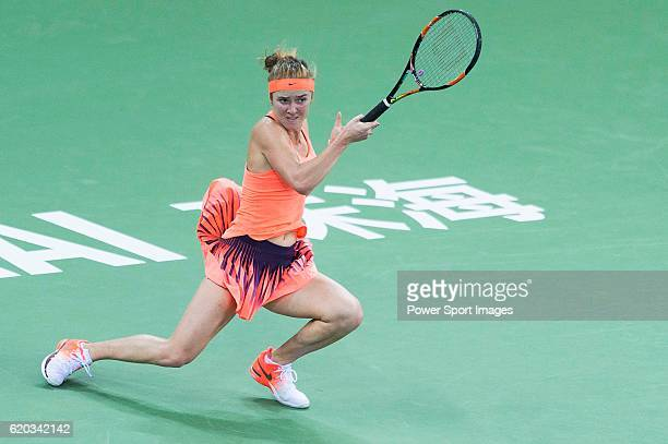 Elina Svitolina of Ukraine plays a forehand against Kiki Bertens of Netherlands during their Singles Round Robin match at the WTA Elite Trophy in...