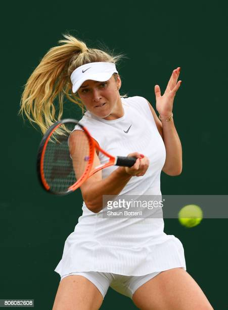 Elina Svitolina of Ukraine plays a forehand during the Ladies Singles first round match against Ashleigh Barty of Australia on day one of the...