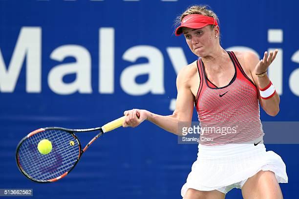 Elina Svitolina of Ukraine plays a return shot to Kristina Kucova of Slovakia during the Quarter Finals of the 2016 BMW Malaysian Open at Kuala...