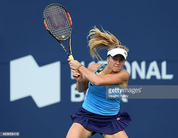 Elina Svitolina of Ukraine plays a shot against Victoria Azarenka of Belarus during Day 2 of the Rogers Cup at the Aviva Centre on August 11 2015 in...