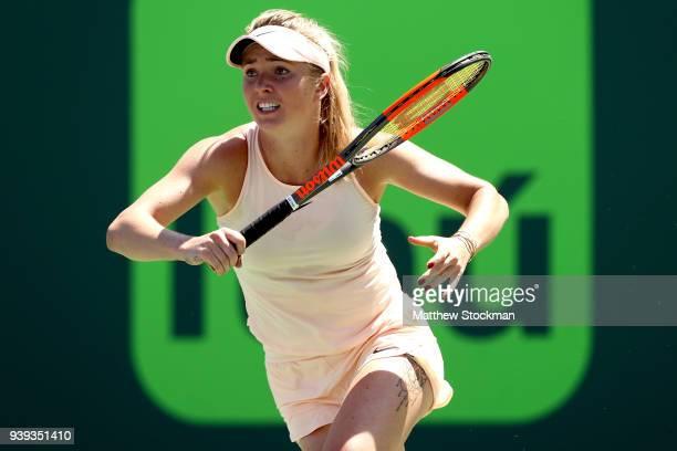 Elina Svitolina of Ukraine plays Jelena Ostapenko of Latvia during the quarterfinals of the Miami Open Presented by Itau at Crandon Park Tennis...