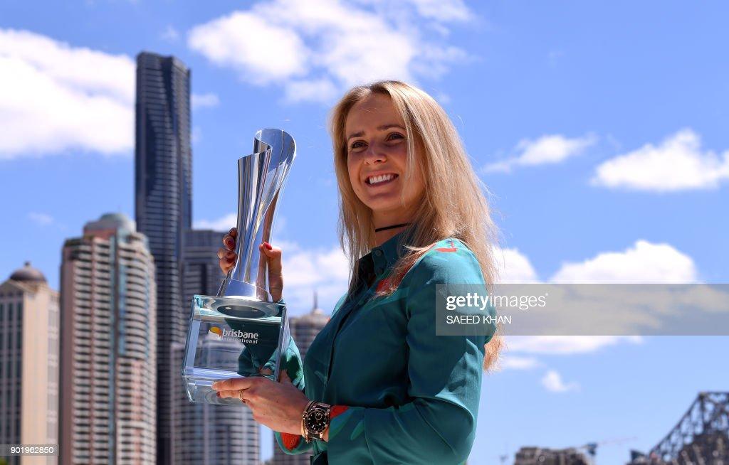 Elina Svitolina of Ukraine poses for photos with her winning Brisbane International trophy at Eagle Street Pier in Brisbane on January 7, 2018. /