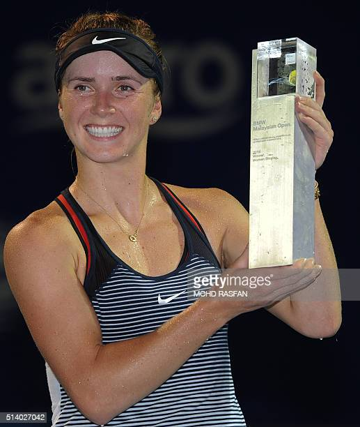 Elina Svitolina of Ukraine poses with her trophy after defeating Eugenie Bouchard of Canada during their final singles match at the BMW Malaysian...