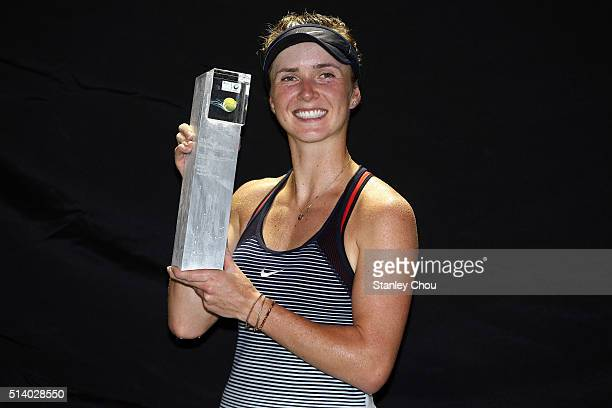 Elina Svitolina of Ukraine poses with the Singles Champion Trophy after she defeated Eugenie Bouchard of Canada during the Singles Final of the 2016...