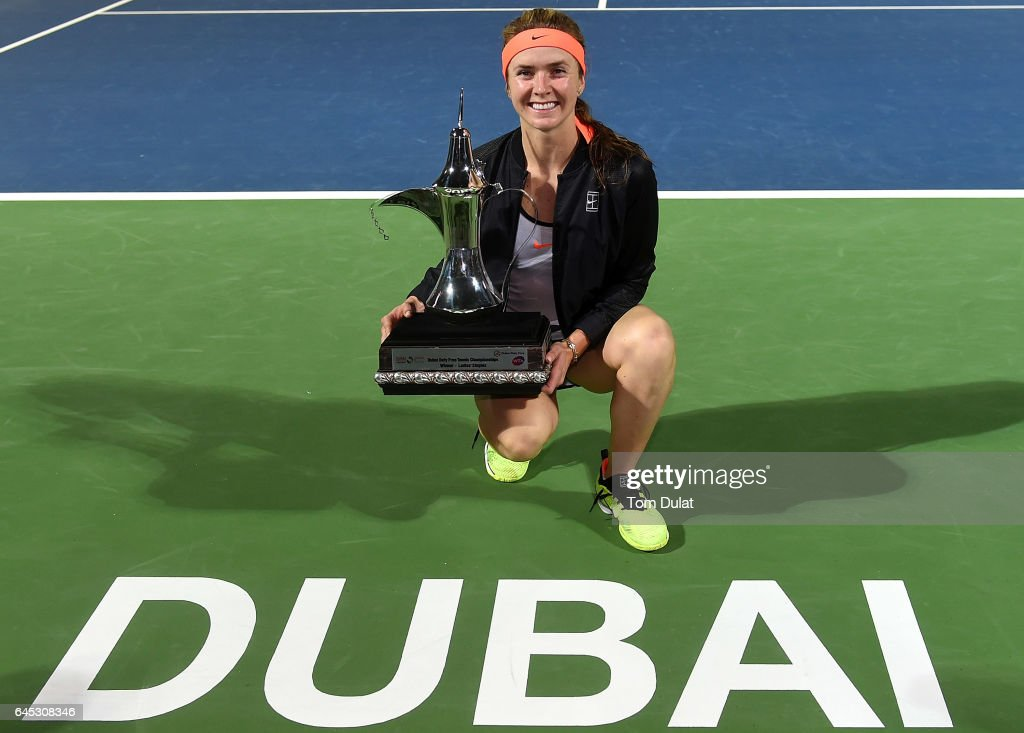 Elina Svitolina of Ukraine poses with the trophy after winning the final match against Caroline Woznacki of Denmark on day seven of the WTA Dubai Duty Free Tennis Championship at the Dubai Tennis Stadium on February 25, 2017 in Dubai, United Arab Emirates.