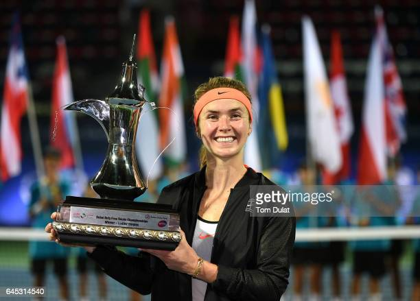 Elina Svitolina of Ukraine poses with the trophy after winning the final match against Caroline Woznacki of Denmark on day seven of the WTA Dubai...