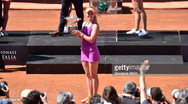Elina Svitolina of Ukraine poses with the trophy after winning the WTA Singles Final match against Simona Halep of Roumania during The Internazionali...