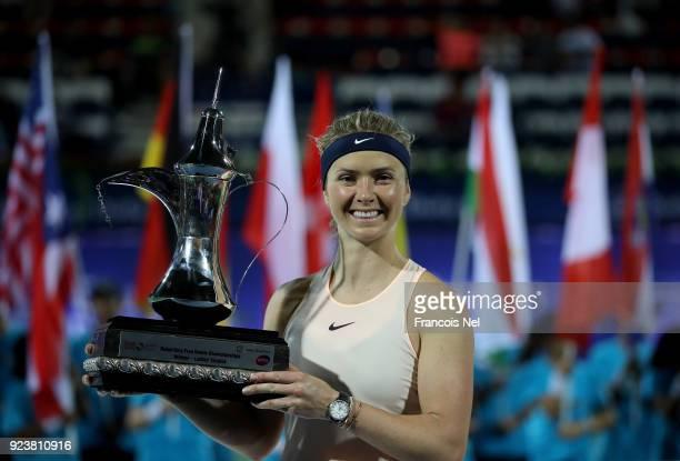 Elina Svitolina of Ukraine poses with the trophy after winning the WTA Dubai Duty Free Tennis Championship at the Dubai Duty Free Stadium on February...
