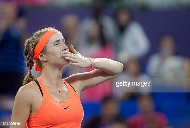 Elina Svitolina of Ukraine reacts after winning the singles semifinal match against Johanna Konta of Britain at the WTA Elite Trophy tennis...