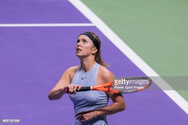 Elina Svitolina of Ukraine reacts in her singles match against Simona Halep of Romania during the BNP Paribas WTA Finals Singapore presented by SC...