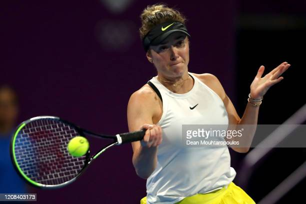 Elina Svitolina of Ukraine returns a forehand against Amanda Anisimova of USA during Day 2 of the WTA Qatar Total Open 2020 at Khalifa International...