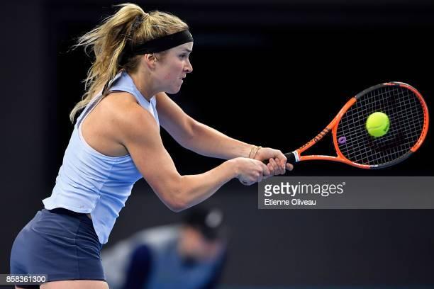 Elina Svitolina of Ukraine returns a shot against Caroline Garcia of France during their Women's singles Quarterfinal match on day seven of 2017...