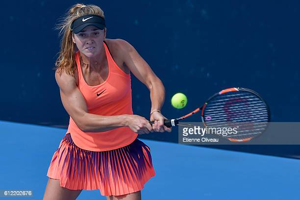 Elina Svitolina of Ukraine returns a shot against Tatjana Maria of Germany during the Women's singles first round match on day three of the 2016...