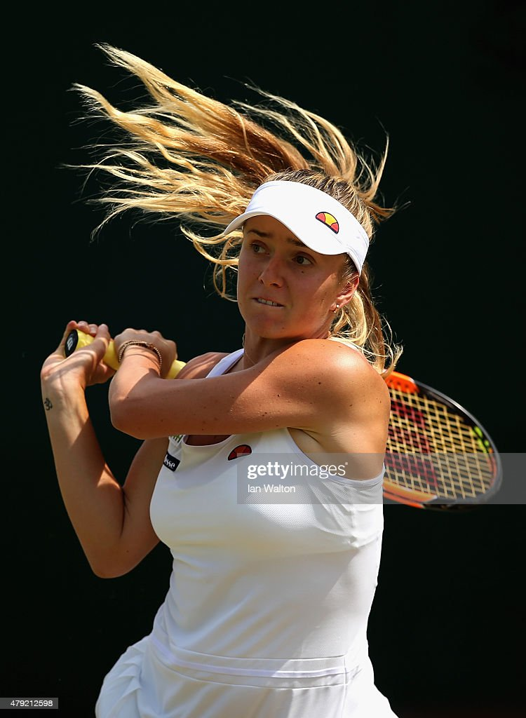 Elina Svitolina of Ukraine returns a shot in her Ladies Singles Second Round match against Casey Dellacqua of Australia during day four of the Wimbledon Lawn Tennis Championships at the All England Lawn Tennis and Croquet Club on July 2, 2015 in London, England.