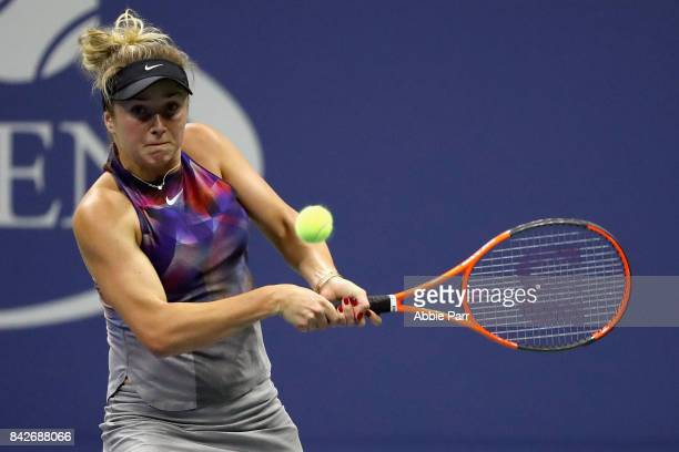 Elina Svitolina of Ukraine returns a shot Madison Keys of the United States during their women's singles fourth round match on Day Eight of the 2017...