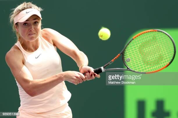 Elina Svitolina of Ukraine returns a shot to Jelena Ostapenko of Latvia during the quarterfinals of the Miami Open Presented by Itau at Crandon Park...