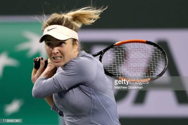 Elina Svitolina of Ukraine returns a shot to Marketa Vondrousova of Czech Republic during the BNP Paribas Open at the Indian Wells Tennis Garden on...