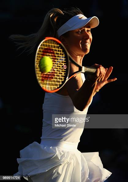 Elina Svitolina of Ukraine returns against Tatjana Maria of Germany during their Ladies' Singles first round match on day one of the Wimbledon Lawn...