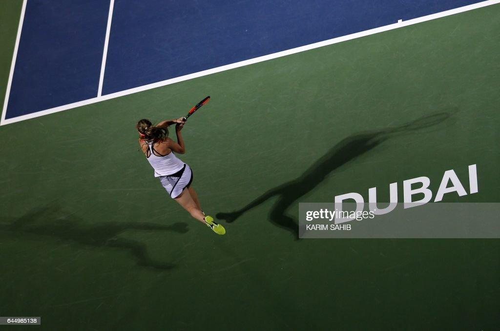 TOPSHOT - Elina Svitolina of Ukraine returns the ball to Angelique Kerber of Germany during their third semi final women's WTA Tennis Championship in Dubai on February 24, 2017. Angelique Kerber lost the chance to return to the top of the WTA rankings, after losing 6-3, 7-6 (7/3) to Elina Svitolina in the Dubai Tennis Championships semi-finals. /