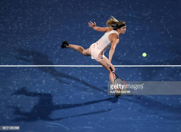 Elina Svitolina of Ukraine returns the ball to China's Wang Qiang during their match on the second day of the WTA Dubai Duty Free Tennis Championship...