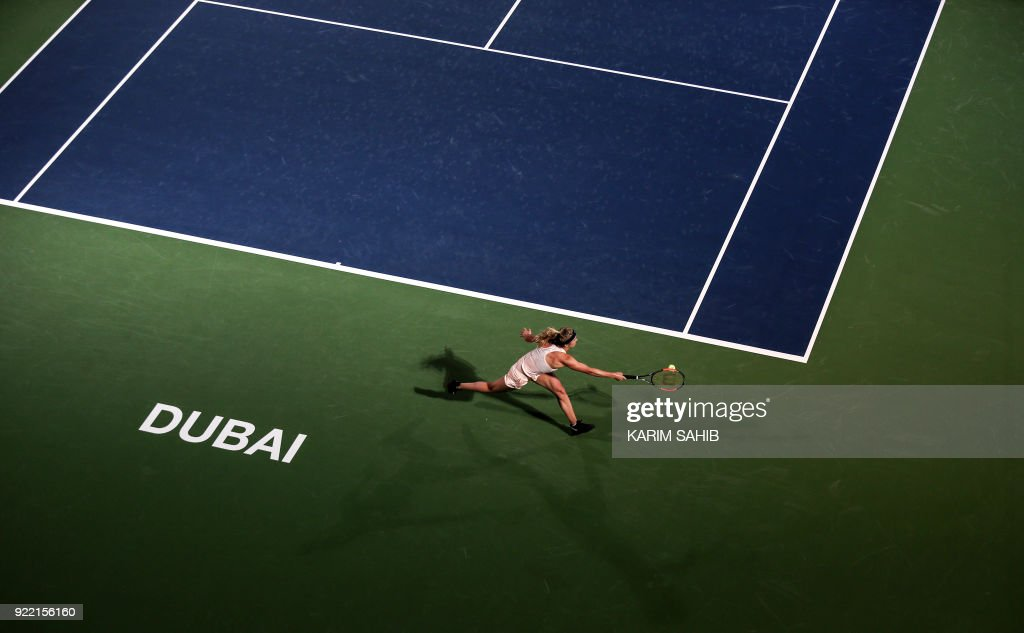 Elina Svitolina of Ukraine returns the ball to China's Wang Qiang (unseen) during their match on the second day of the WTA Dubai Duty Free Tennis Championship at the Dubai Tennis Stadium on February 21, 2018. /