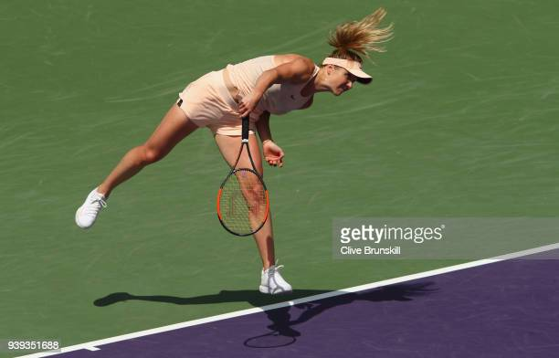 Elina Svitolina of Ukraine serves against Jelena Ostapenko of Latvia in their quarter final during the Miami Open Presented by Itau at Crandon Park...