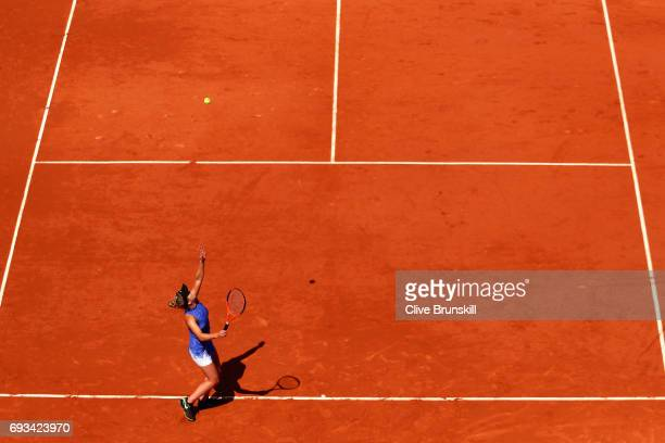 Elina Svitolina of Ukraine serves during ladies singles quarter finals match against Simona Halep of Romania on day eleven of the 2017 French Open at...