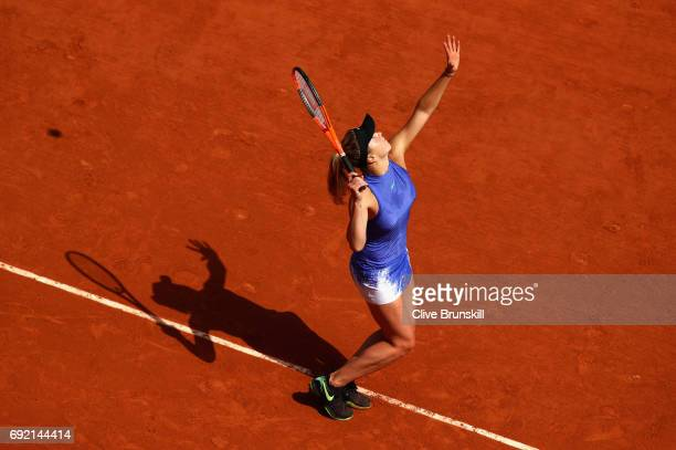 Elina Svitolina of Ukraine serves during the ladies singles third round match against Magda Linette of Poland on day eight of the 2017 French Open at...
