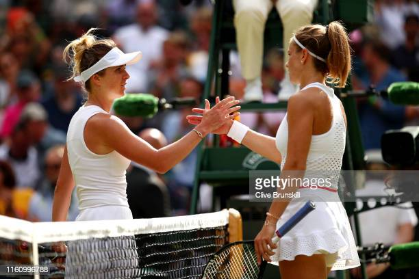 Elina Svitolina of Ukraine shakes hands with Karolina Muchova of Czech Republic following victory in her Ladies' Singles Quarter Final match during...