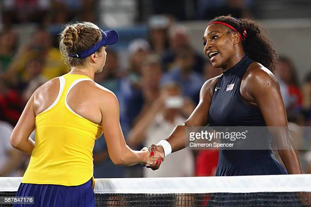 Elina Svitolina of Ukraine shakes hands with Serena Williams of the United States after their Women's Singles Third Round match on Day 4 of the Rio...