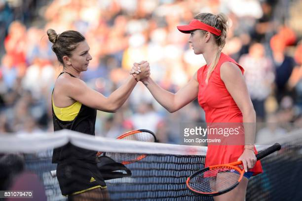 Elina Svitolina of Ukraine shakes hands with Simona Halep of Romania after winning her semifinals match of the 2017 Rogers Cup tennis tournament on...