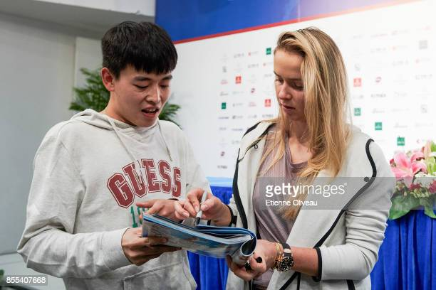Elina Svitolina of Ukraine signs an autograph during a meeting with fans in the preview day of the 2017 China Open at the China National Tennis...