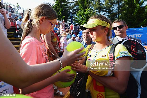 Elina Svitolina of Ukraine signs autographs after winning her match against Mona Barthel of Germany during Day 6 of the Nuernberger Versicherungscup...