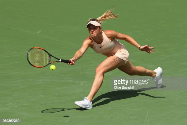 Elina Svitolina of Ukraine stretches to play a forehand against Jelena Ostapenko of Latvia in their quarter final during the Miami Open Presented by...