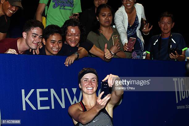 Elina Svitolina of Ukraine takes a selfie with fans to celebarte after she defeated Eugenie Bouchard of Canada during the Singles Final of the 2016...