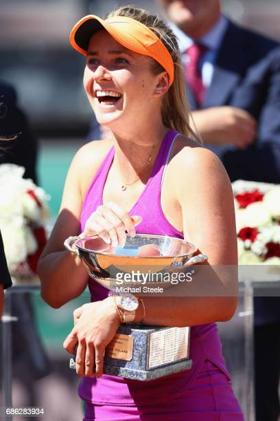 Elina Svitolina of Ukraine with the winners trophy after her victory in the women's final against Simona Halep of Romania on Day Eight of the...