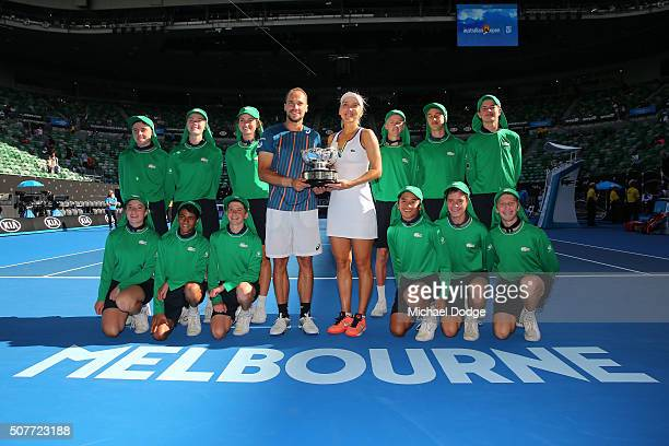Elina Vesina of Russia and Brunos Soares of Brazil and the ballkids pose with the trophy after winning the Mixed Doubles Final match against Coco...