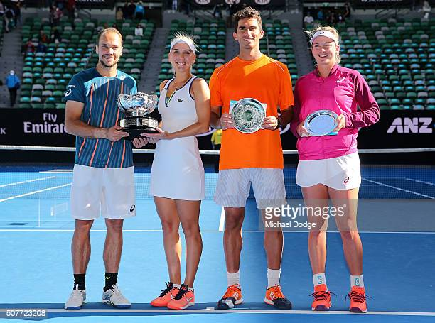 Elina Vesina of Russia and Brunos Soares of Brazil pose with the trophy after winning the Mixed Doubles Final match against Coco Vanderweghe of the...