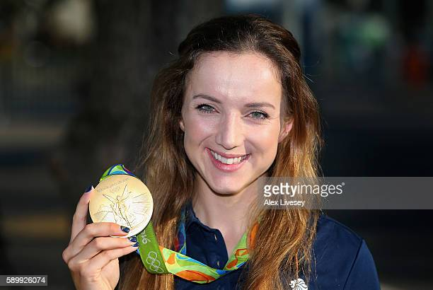 Elinor Barker of Great Britain poses for photographs with her gold medal won in the Women's Team Pursuit Cycling in front of the Olympic Park on day...