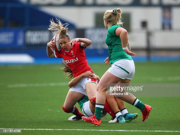 Elinor Snowsill of Wales is tackled by Cliodhna Moloney of Ireland during the Women's Six Nations match between Wales and Ireland at Cardiff Arms...